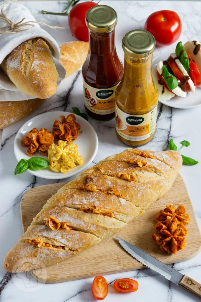 Rezept zum Backen. Das Dinkel Baguette passt hervorragend als Brot zum Grillen. Zusammen mit leckerer Grillbutter hast du eine tolle Alternative zu Kräuter- und Knoblauchbaguette. Küchentraum & Purzelbaum